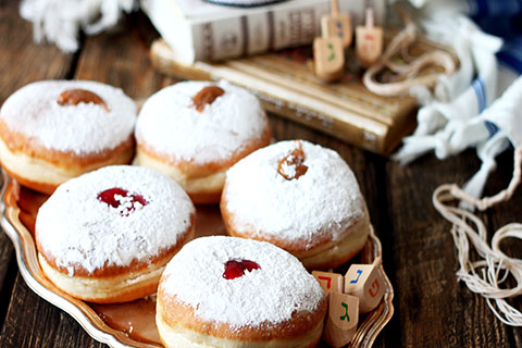 This is a stock photo. Traditional Jewish donuts filled with jam.