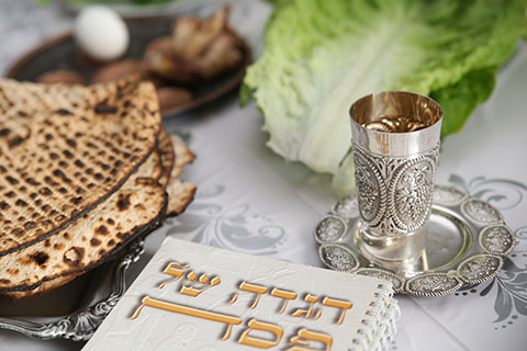 This is a stock photo. A close up view of a Passover Seder table.