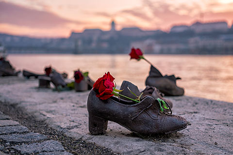 This is a stock photo. The shoes on Danube Bank are a Holocaust memorial to honor the Jews who were killed in Budapest, Hungary during World War II.